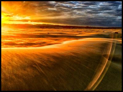 BLOWING SAND AT SUNRISE, NEWPORT OREGON