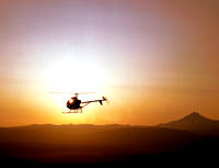 HELICOPTER AT SUNSET-HUGHES 300